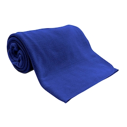 A royal blue fleece blanket is rolled up with just a bit of the blanket unrolled for display.