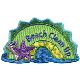 The middle hump of a sea serpent. The words \'Beach Clean Up\' are embroidered along the right of the hump. A starfish with tin can rest on the left most section of the hump.