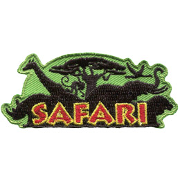 From left to right are the silhouettes of a rhino, a giraffe, a baboon hanging from a baobab tree, a stork, an elephant, and a lion. The word \'Safari\' is embroidered over the shilhouettes.