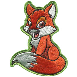 This cute red fox is a small forest creature with a reddish-brown coat, with white underparts, except for a black tipped nose and lower legs. It also has a large, very noticeable, bushy tail that is white tipped.