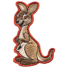 A kangaroo stands tall and smiles.