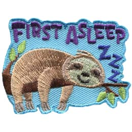 A sloth sleeps on a tree branch. The words \'First Asleep\' are at the top of the crest and \'Zzz\' is by its head.