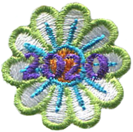 A white daisy-like flower where each petal is outlined in a light green and has a blue line through the middle. The flower has an orange center. The date 2020 rests in the middle of this one inch flower.