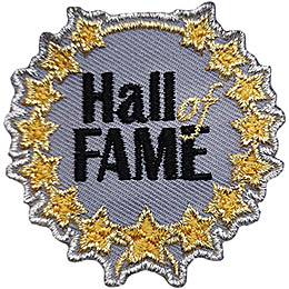 A grey circle has the words \'Hall of Fame\' embroidered in its center. Around the rim is a wreath of golden metallic stars.