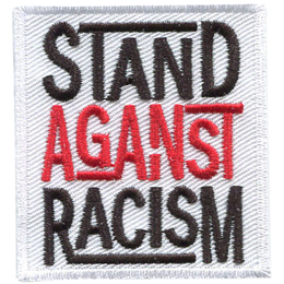 A white rectangle has the words Stand Against Racism embroidered in black, red, and black thread respectively. Each word is stacked on top of the next.