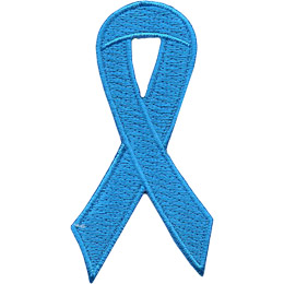 An aqua ribbon is curled on itself to form a simple loop.