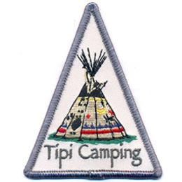 This triangle shaped crest displays a colorfully painted tipi. The words \'\'Tipi Camping\'\' are embroidered underneath the aboriginal structure.