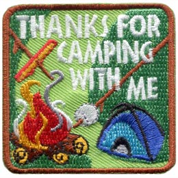 This square patch has the words ''Thanks For Camping With Me'' embroidered in the top right-hand corner. A blue tent sits just underneath. In the bottom left corner a campfire blazes away, smoke gently curling from it. Two roasting sticks are pushed towards the fire: one with a hotdog and the other with a marshmallow.