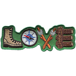 The word 'LOVE' is spelled out using camping objects. A hiking boot forms the 'L,' the 'O' is a compass, two sticks with marshmallows on the ends form a 'V' and the 'E' is made out of wooden logs.