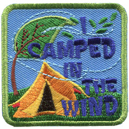 This square patch displays a tree and tent being bent over by the wind. White dotted lines mark the wind's wispy path. The text 'I Camped In The Wind' is stacked on itself from the top right to the bottom right.
