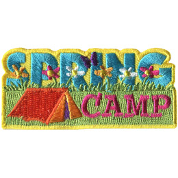 The word 'Spring' is sitting on a field of flowers and green grass. Underneath is a tent sitting beside the word 'Camp'.