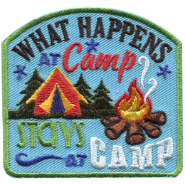 This crest displays the words 'What Happens At Camp Stays At Camp' as well as a tent, three spruce trees, and a campfire. The words 'What Happens At Camp' arch above the tent, trees, and campfire while 'Stays At Camp' rests at the bottom of the crest.