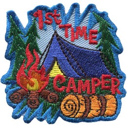 A tent sits in the middle of a three treed forest (two on the left and one on the right). A roaring campfire rests before the tent at the bottom left of the patch and a bedroll sits at the bottom right. The text \'1st Time\' is above the tent and \'Camper\' is below the tent.