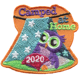 A little owl peeks out of a blanket fort made at home. There is a pillow in front of the owl that reads 2020. Above the fort are the words Camped At Home.