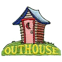 A log outhouse with a moon carved into the door stands perched on a grassy hill with the words ''Outhouse.''