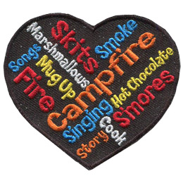 This heart shaped crest has 12 words inside it that describes camping or a camping event. These words are: Campfire, Marshmallows, S\'mores, Roasting, Cooking, Singing, Fire, Stories, Songs, Skits, Mug Up, Hot Chocolate, and Smoke.