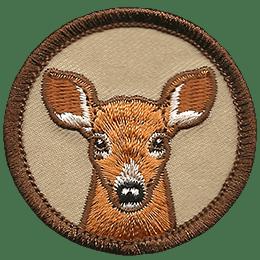 This circle badge displays an antlerless deer portrait.