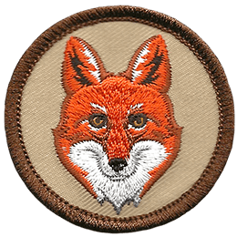This circular badge displays the head of a red fox.
