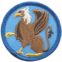A majestic gryphon is poised sitting with one of its foreclaws raised.