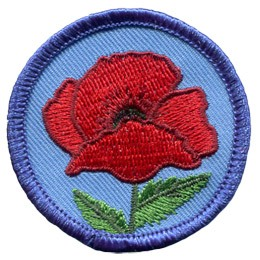 A red poppy stands alone with only two leaves adorning its straight stem. A merrow border frames this circle badge.