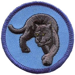 A black panther gracefully turns, its piercing yellow eyes staring out of this circular crest.