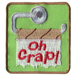 A camper's worst nightmare: an empty toilet paper roll sits on the hook. The last scraps of paper have the words 'Oh Crap!' written on it.