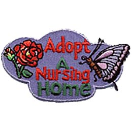 The words ''Adopt A Nursing Home'' are written in the center of this oddly shaped patch. Bubbling out to the right is a butterfly and to the left is a rose.