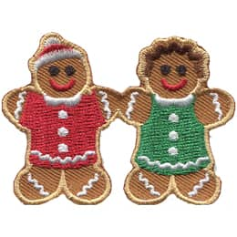 A gingerbread man and woman hold hands.