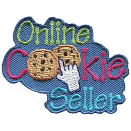This crest is composed of the words \'Online Cookie Seller\'. The two \'O\'s in \'Cookies\' are two chocolate chip cookies. A computer pointer hand is on top of the double cookies ready to click.