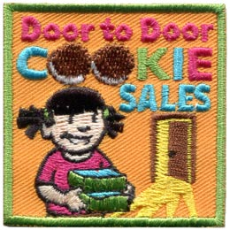 A young girl approaches an open door with two boxes of cookies in her hands. The words 'Door to Door Cookie Sales' is embroidered at the top of the patch. The double 'o' in 'Cookie' have been replaced with pictures of chocolate cookies.