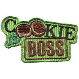 This crest is comprised of the words 'Cookie Boss.' 'Cookie' is written on a diagonal slant and the word's double 'o' has been replaced by mint cookies. The word 'Boss' is underneath and looks like it has been stamped.