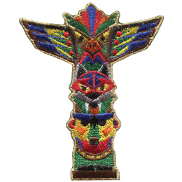 A totem pole showcases a monkey at the bottom, a wolf in the middle, and an eagle at the top. The totem pole has been painted in vibrant colours.