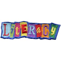 The word ''Literacy'' is spelled out horizontally where each letter is set in a different coloured box and at slightly tilted angles.