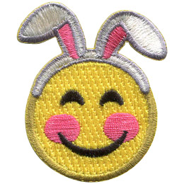 A yellow circle forms a smiley face with smiling eyes, rosy cheeks, and a big U-shaped smile. This emoji is wearing a headband with floppy bunny ears.