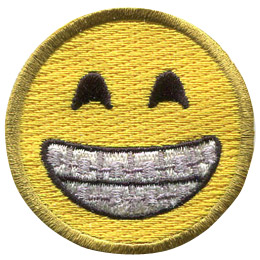 A yellow circle forms a smiley face with smiling eyes and a wide, toothy grin proudly displaying braces.