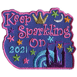 This crest is comprised of the words \'Keep Sparkling On 2021\'. A castle is positioned in the bottom right of the crest while a crown sits at the top. Stars decorate this patch.
