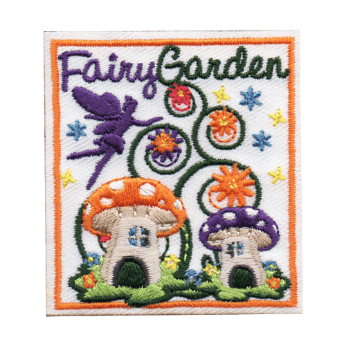 A fairy flies above two mushroom houses placed in a beautiful garden. Vines spiral upwards and bloom into flowers. At the top of the crest is text that reads, \'Fairy Garden\'.