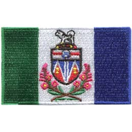 The Yukon flag is comprised of three vertical bars: a green, white, and blue from the left to the right. Yukon\'s provincial shield and flowers decorates the center of the flag.