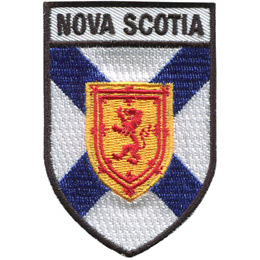 This shield shaped badge has a horizontal bar at the top with the name 'Nova Scotia' in it. The rest of the crest has a white background with a blue X splitting the background. A golden shield with a red lion on it sits in the middle of the X.