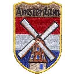 This red, white, and blue horizontal stripped patch has the word ''Amsterdam'' embroidered at the top of this shield shaped patch. A old fashioned windmill is centered over top of the stripes.