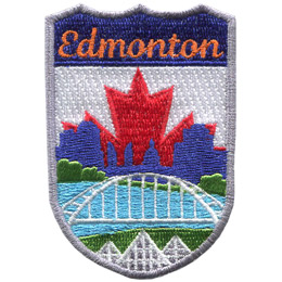 This emblem has the name \'Edmonton\' at the top on a blue background. In the section below the name is Edmonton\'s famous landmarks. From bottom to top are the three pyramids of the Muttart Conservatory, the Waterdale Bridge, the North Saskatchewan River, and downtown Edmonton (including the Legislature Building). The background is a red maple leaf on a white backing.
