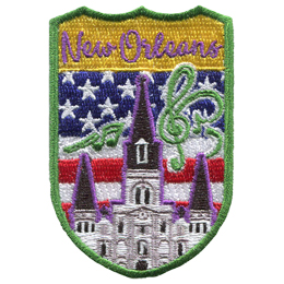 This crest displays St. Louis Cathedral of New Orleans surrounded by musical notes. In the background is the USA flag.