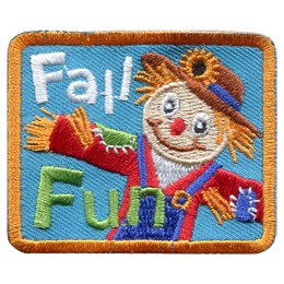 A happy scarecrow smiles out from this blue background patch. The straw-filled scarecrow is wearing a straw hat with a sun flower on it, a patched red coat, a white under shirt, and blue overalls. The words 'Fall Fun' are embroidered on this crest.