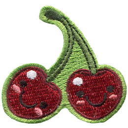 Two red cherries are attached together at the stems. Both cherries have dots for eyes and a big U shaped smile.
