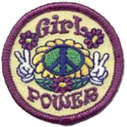 A round 2'' patch has a sunflower with a peace sign as its center and has two hands holding up two fingers each in the ''peace'' sign. The word ''Girl'' is embroidered at the top and ''Power'' at the bottom. Purple daisies decorate the patch.