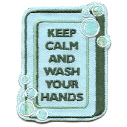 A vertically positioned bar of soap has soap-sud bubbles at the top right and bottom left. On the bar is the text Keep Calm and Wash Your Hands.