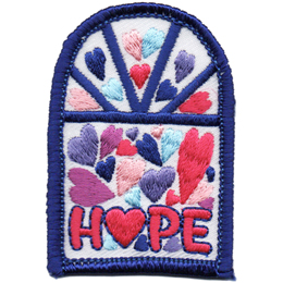 A window is filled with hearts of different colours. At the bottom of the window is the word Hope.