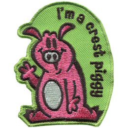 A piggy sits and waves. Text flows in a curve from the top to the bottom right of the patch. The text reads I\'m a crest piggy.