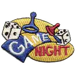 The spotlight is on a strip of a board game with repeating blue then yellow squares. Plastic game pieces and dice fly as if the board has been bumped. The word ''Game'' is written on the game board and ''Night'' in the spotlight that shines underneath the game board.