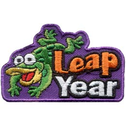 A green frog has his front legs outstretched as he happily lands a flying leap beside the words \'\'Leap Year\'\'.